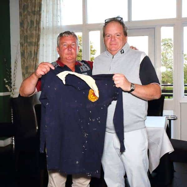 Jonathan Harvey (right) presents the Scotland shirt to James Alfred Smith for display in the Scottish Section office.