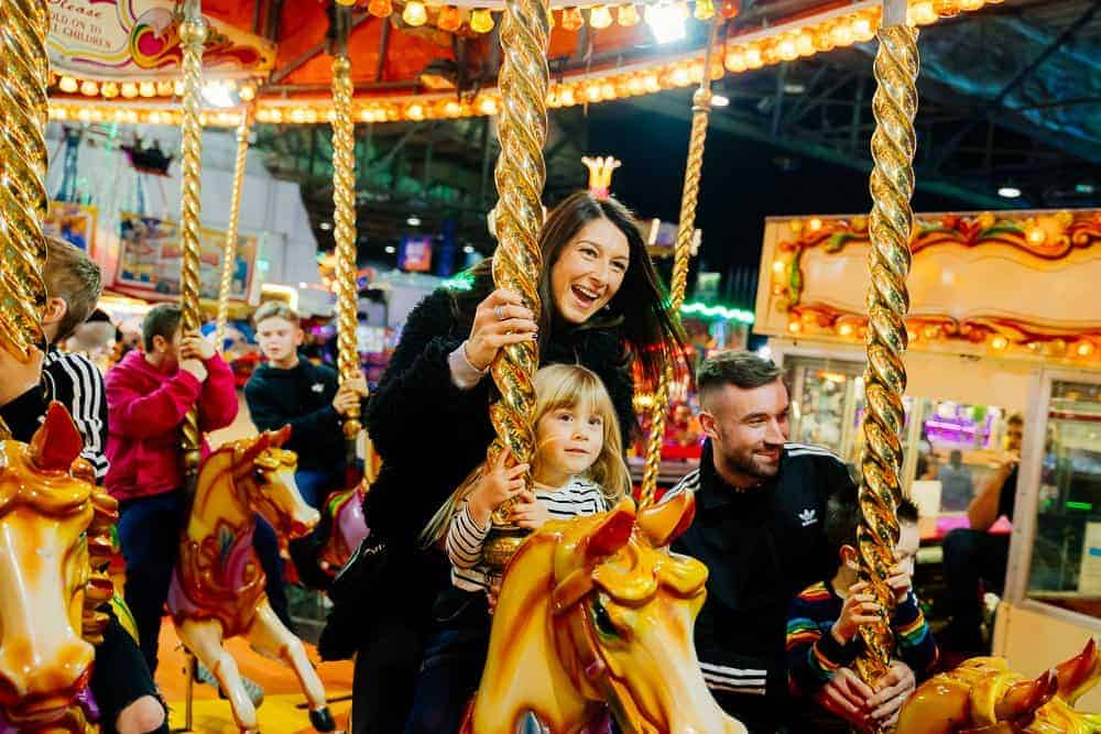 carnival people happy on carousel image
